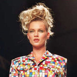 Walking in a runway show in 1995, Kate was in her '90s glory with wild hair and emerald green eye shadow.
