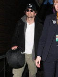 Bradley Cooper carried a black bag.