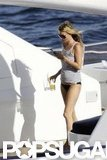 Kate Moss checked her phone while on a yacht near Sardinia in July of 2008.
