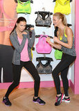 Adriana Lima and Erin Heatherton joked around at the VSX launch at Victoria's Secret Herald Square in NYC.
