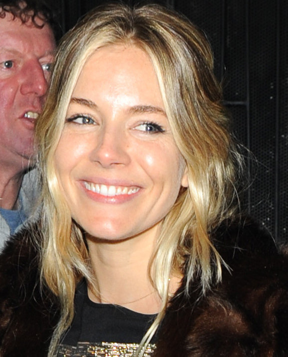 Sienna Miller smiled in London.