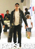 Robert Pattinson traveled with his guitar.
