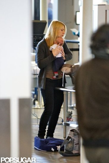 Claire Danes held baby Cyrus Dancy tight at LAX.