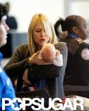 Claire Danes carried new baby Cyrus Dancy through LAX.