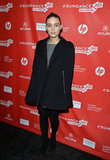 Rooney Mara kept it chic at the Emanuel and the Truth About Fishes premiere wearing a grey dress, black cape coat, and booties.