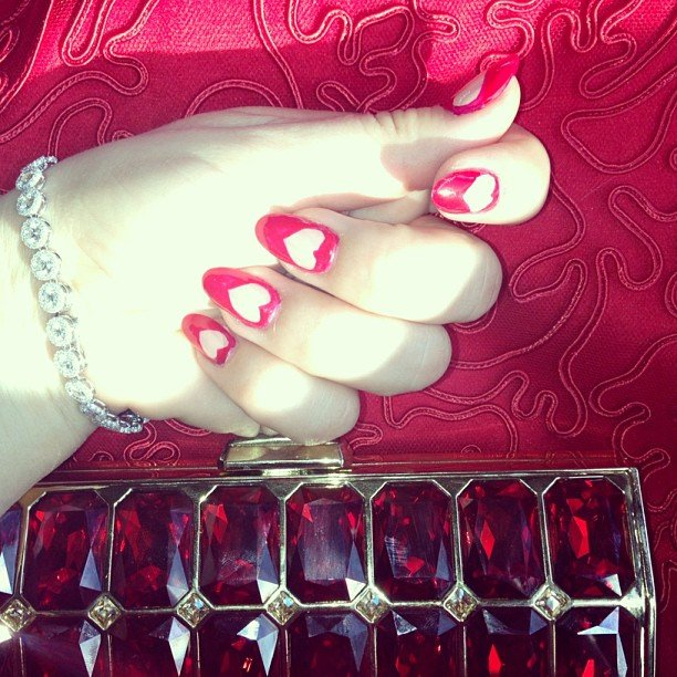 Hearts adorned the nails of actress Kaley Cuoco for the SAG Awards, matching the rest of her red feminine look. Source: Instagram user normancook