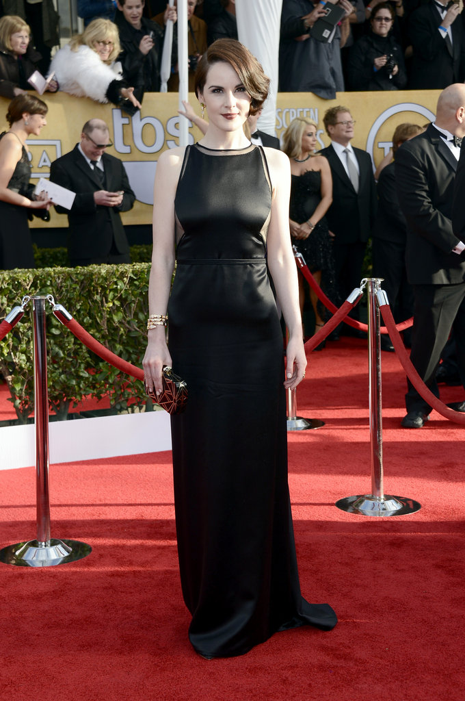 Michelle Dockery was statuesque in a vintage atin Chado Ralph Rucci gown, with side cut-outs and Bulgari jewels.