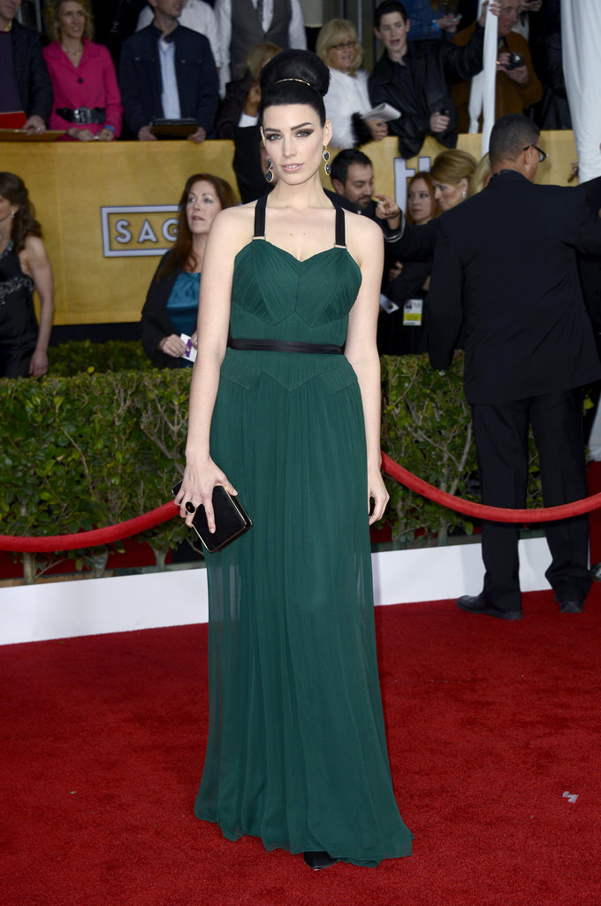 Jessica Pare looked stunning in a dark green pleated Jason Wu gown with black accents, top-notch top-knot and stunning drop earrings.