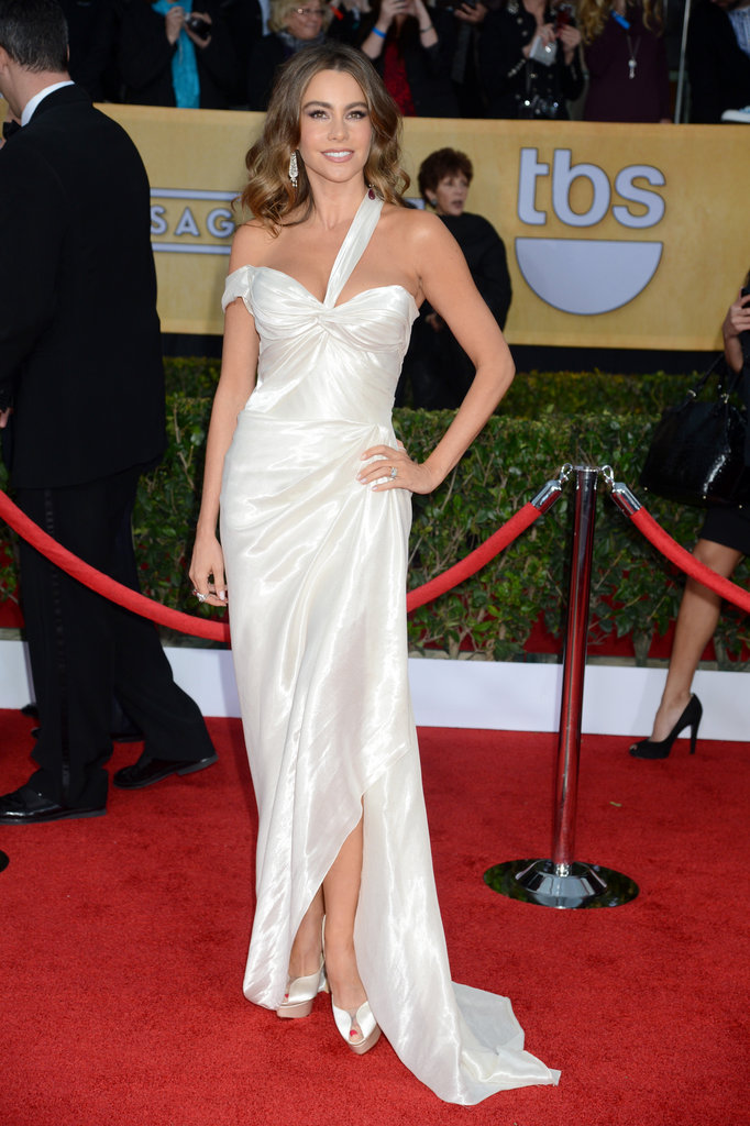 Sofia Vergara had a goddess moment in a white liquid lamé Donna Karan Atelier gown with Charlotte Olympia peep-toes and a Jimmy Choo bag.