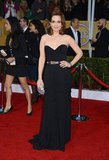 Tina Fey looked effortlessly glamourous in a strapless corseted Oscar de la Renta gown. A metallic belt, matching clutch and retro waves took her SAG Awards ensemble to new heights.