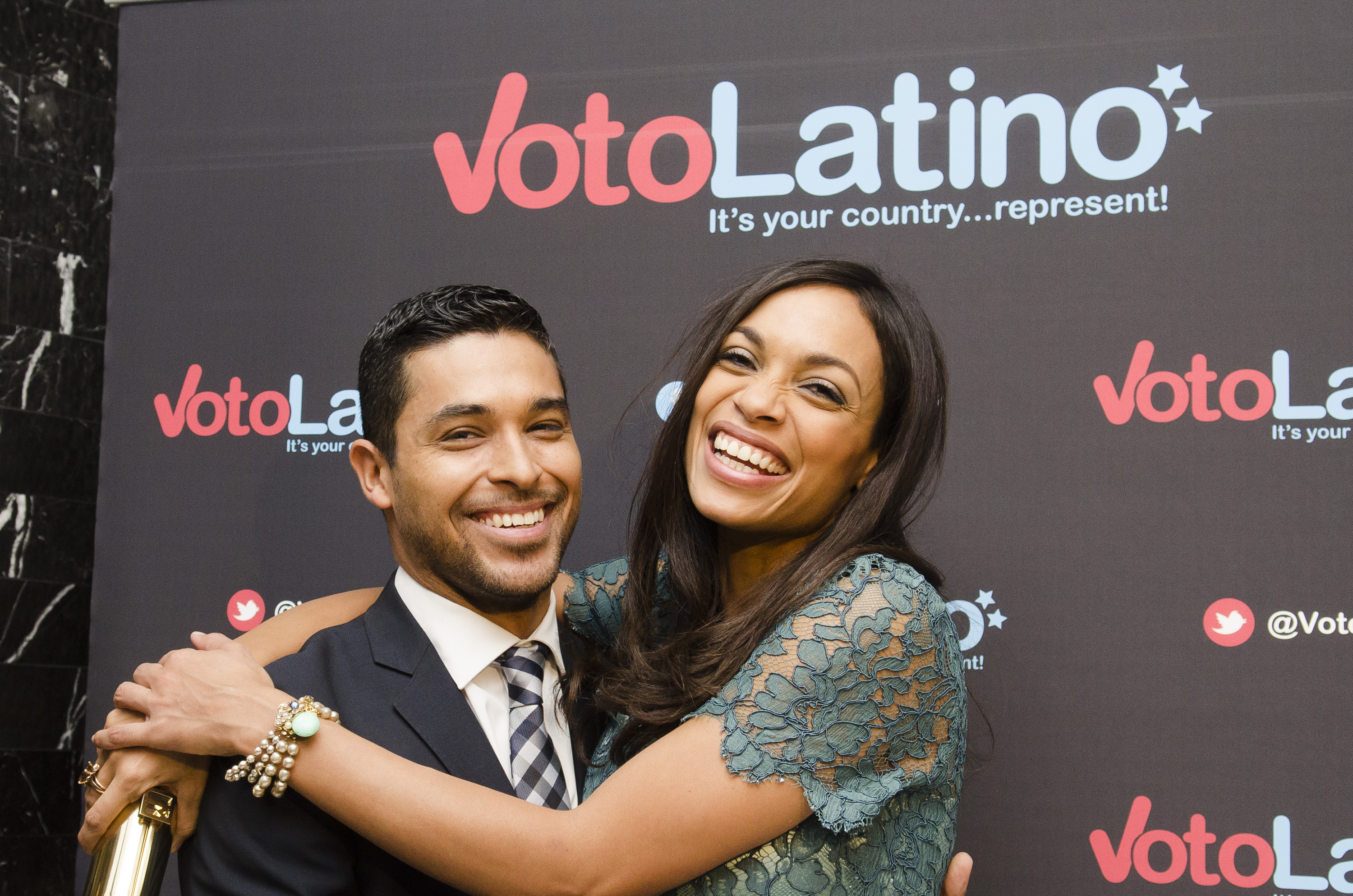 Wilmer Valderrama and Rosario Dawson hugged for pictures at the Voto Latino 2013 inauguration celebration Sunday.
