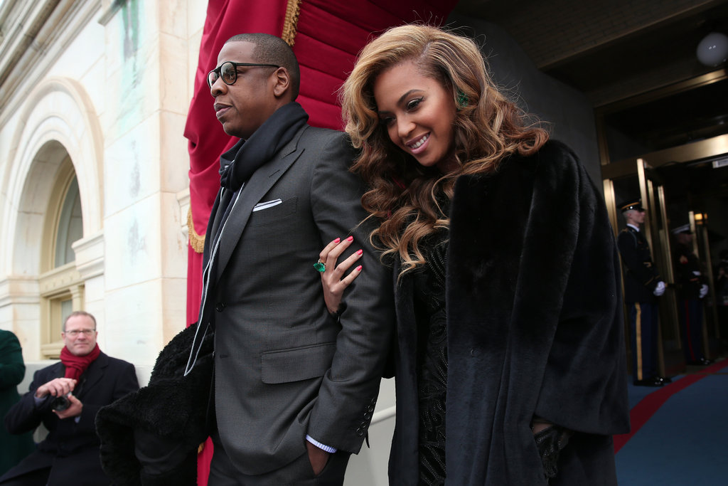 Beyonce Knowles had her man by her side Monday before she performed the national anthem.