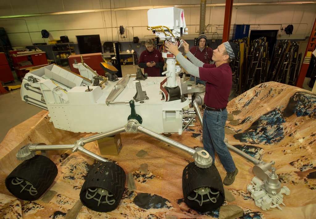 The Mars Curiosity Rover replica gets a little readjustment. Source: Flickr User NASA HQ
