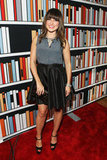 Sophia Bush arrived at the Elle magazine and Google event wearing a printed sleeveless blouse paired with a black pleated skirt and ankle-strap platform pumps.