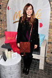 Ahna O'Reilly mixed neutrals with a whiskey-colored Coach crossbody bag, Citizens of Humanity Avedon skinny jeans, a classic black peacoat, and matching leather boots, both by Tory Burch.