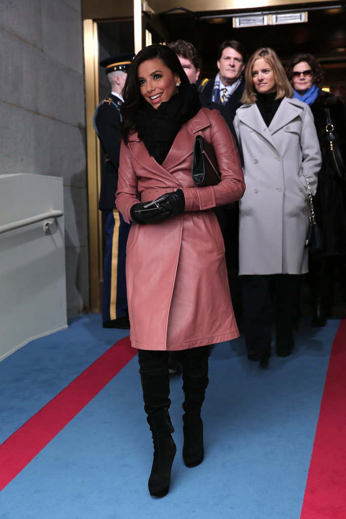 Eva Longoria showed her support at the capitol today in a salmon-hued trench coat by Bally and a bevy of black Winter accessories.