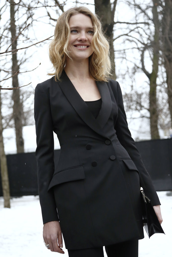Natalia Vodianova smiled for photographers in a black double-breasted jacket dress — a chic menswear meets cocktail-inspired choice for the supermodel.