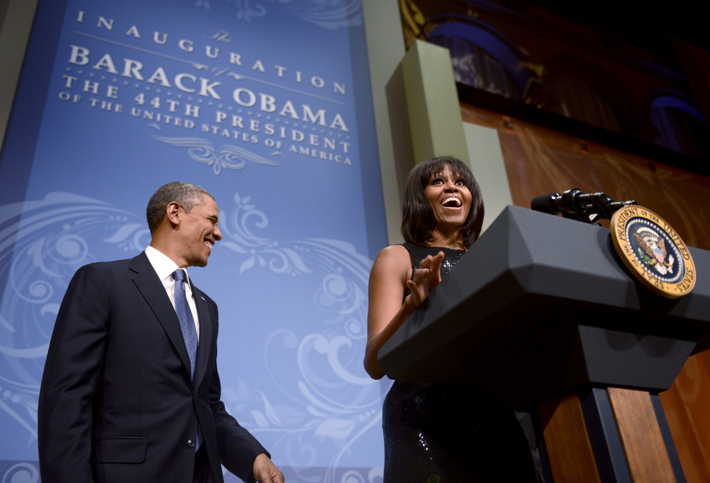 President Barack Obama laughed while wife Michelle spoke during the inaugural reception.