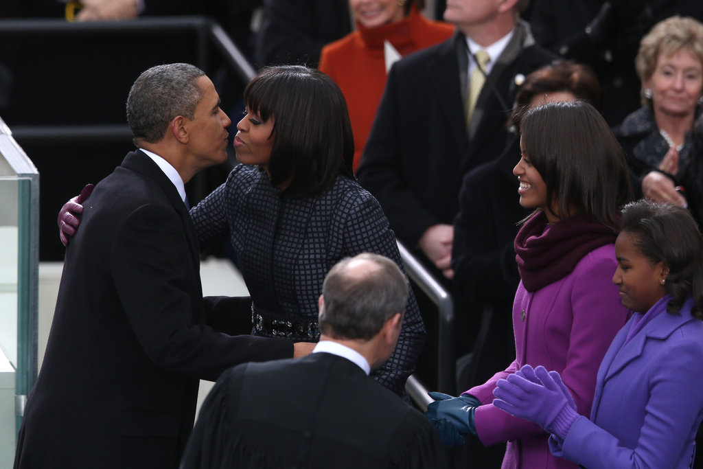 Barack and Michelle Obama went in for a kiss.