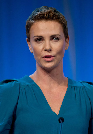 Charlize Theron wore a turquoise dress with her short hair.