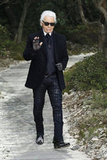 Karl Lagerfeld waved to spectators at the Chanel Haute Couture fashion show.