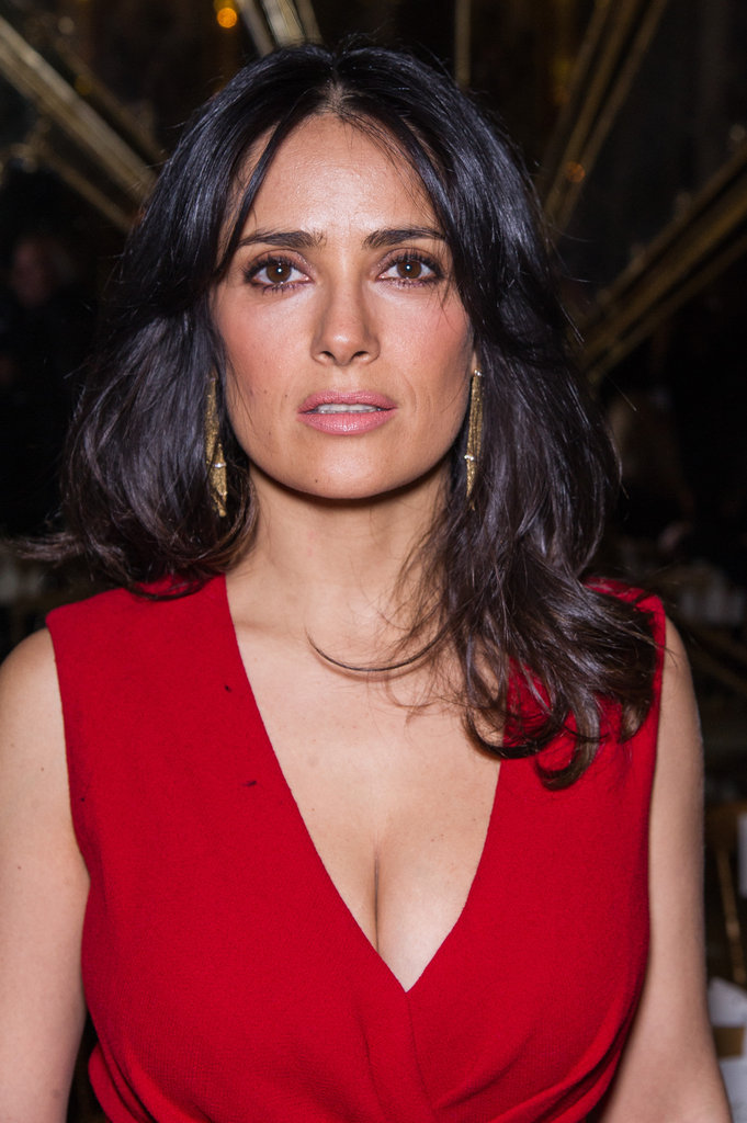 Salma Hayek paired her red dress with gold earrings.