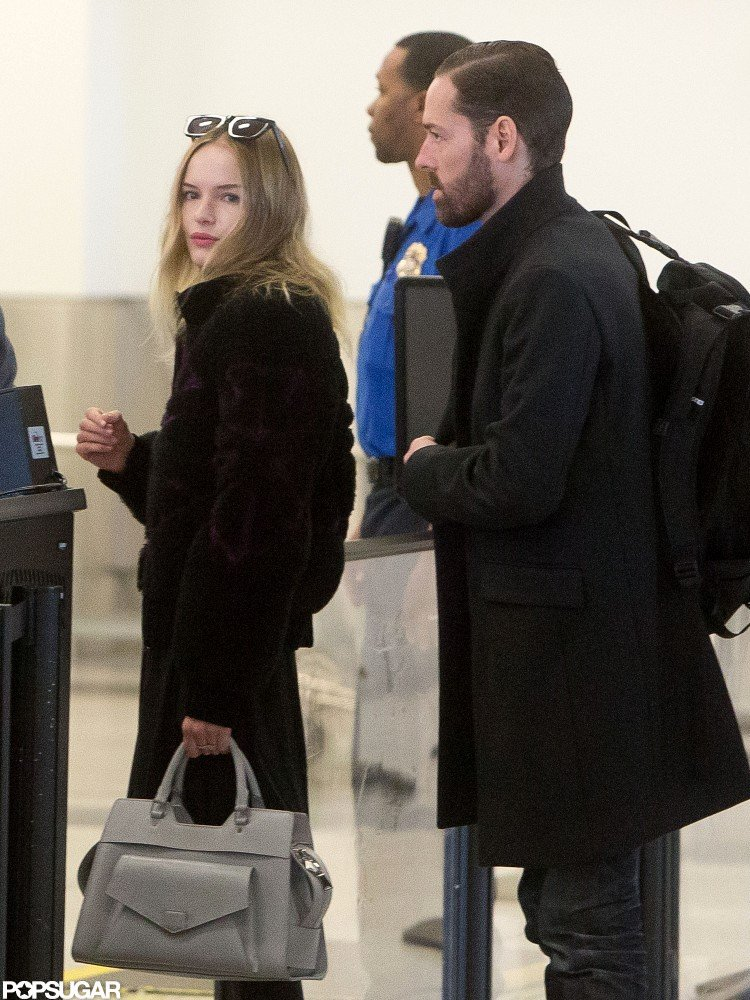 Kate Bosworth and Michael Polish lined up to go through security.