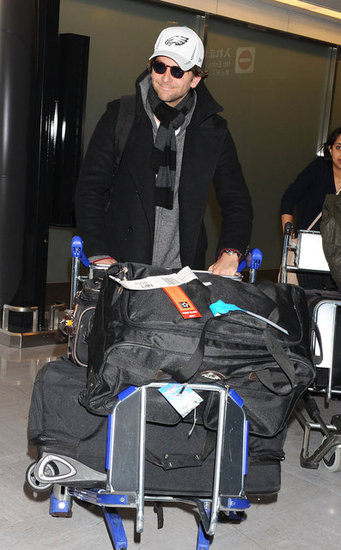 Bradley Cooper had a smile on his face as he pushed his luggage through the airport in Japan.