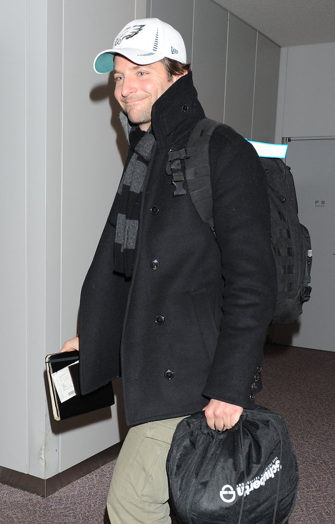 Bradley Cooper smiled as he made his way through the airport in Japan.