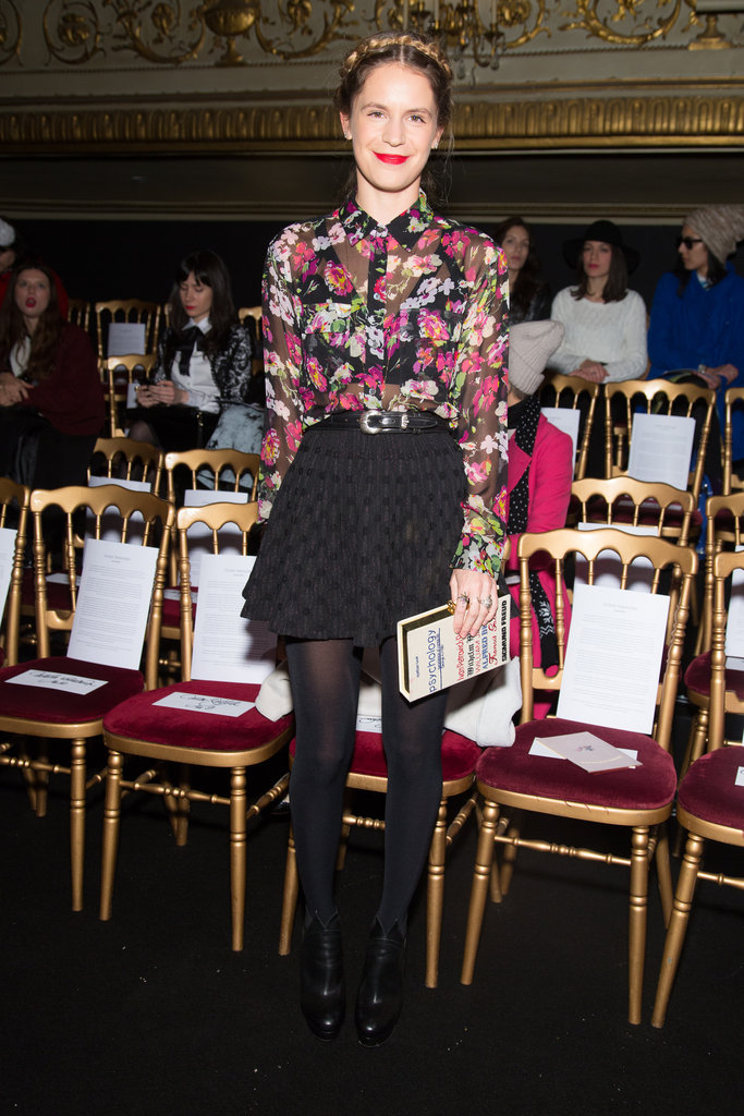 Eugenie Niarchos also went the floral route in a sheer floral blouse, which she buttoned up all the way and tucked into a black miniskirt.