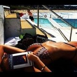 Lara Bingle sunned herself in a printed bikini while reading The Great Gatsby. Source: Instagram user mslbingle