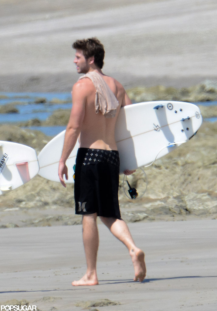Liam Hemsworth wore black swim trunks.