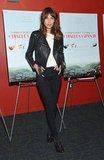 Alexa Chung attended a movie screening in NYC sporting a cropped black leather biker jacket with a white tee, black skinny jeans, and clog booties. She kept her feet especially warm with black ribbed socks.