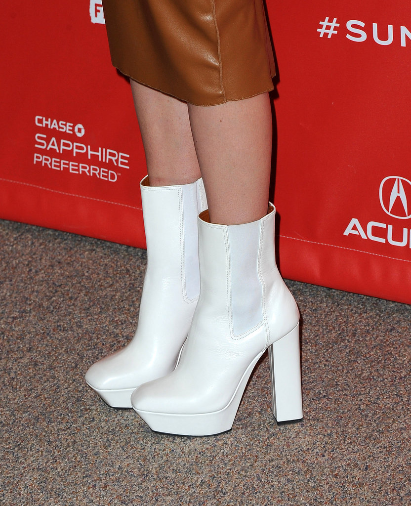 Kate finished off her look with white calf-length boots.