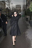 Dita Von Teese strolled Paris in a glittery black coat, satin pumps, and dramatic cat-eye shades.
