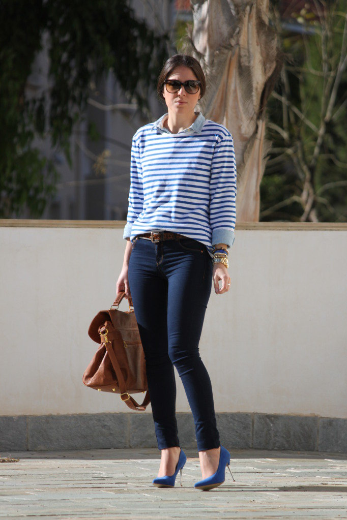 Preppy with a twist, thanks to a striped tee layered over a collared shirt and finished with polished pumps. Source: Lookbook.nu