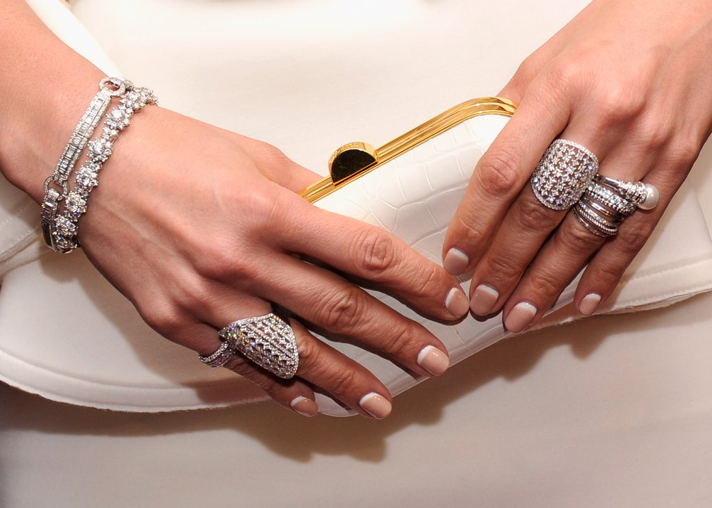 A white Lanvin clutch and handful of statement jewels completed her stunning look at the MOMA Parker screening. Looking to get the same look? Simply stack your silver or gold jewels until your hands and wrists shine.