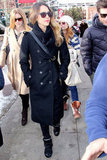 Jessica Alba strolled Park City in a Tory Burch trench coat, coated denim, and high-top sneakers. The trendsetter accessorized with a leather Marni crossbody, square shades, and a cozy scarf.