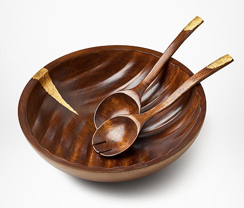 Gold-leaf accents give this wooden salad set ($180) a luxe upgrade.