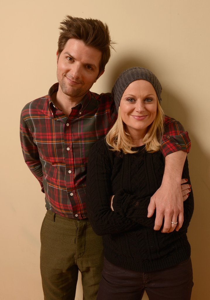 A.C.O.D's Adam Scott wrapped his arm around costar Amy Poehler during their photo shoot.