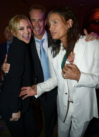 Kate Hudson smiled with Joe buck and Steven Tyler at the Raise Your Voce benefit in LA.