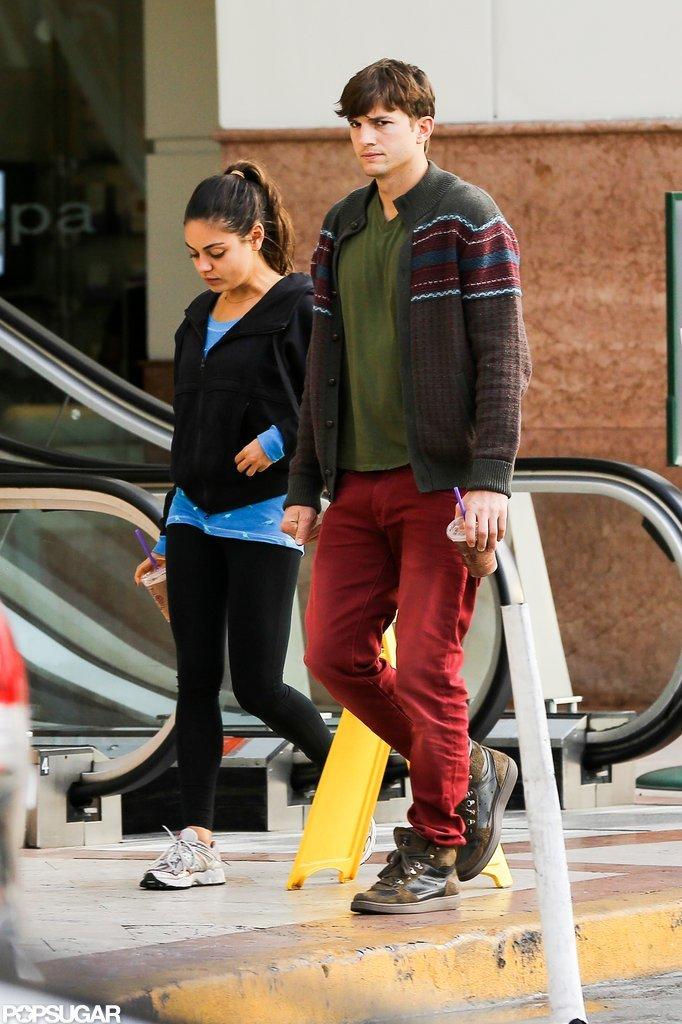 Mila Kunis wore black leggings to grab a coffee with boyfriend Ashton Kutcher in LA.