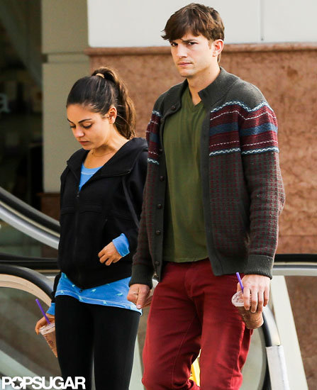 Mila Kunis and Ashton Kutcher headed out of a Coffee Bean in LA together.