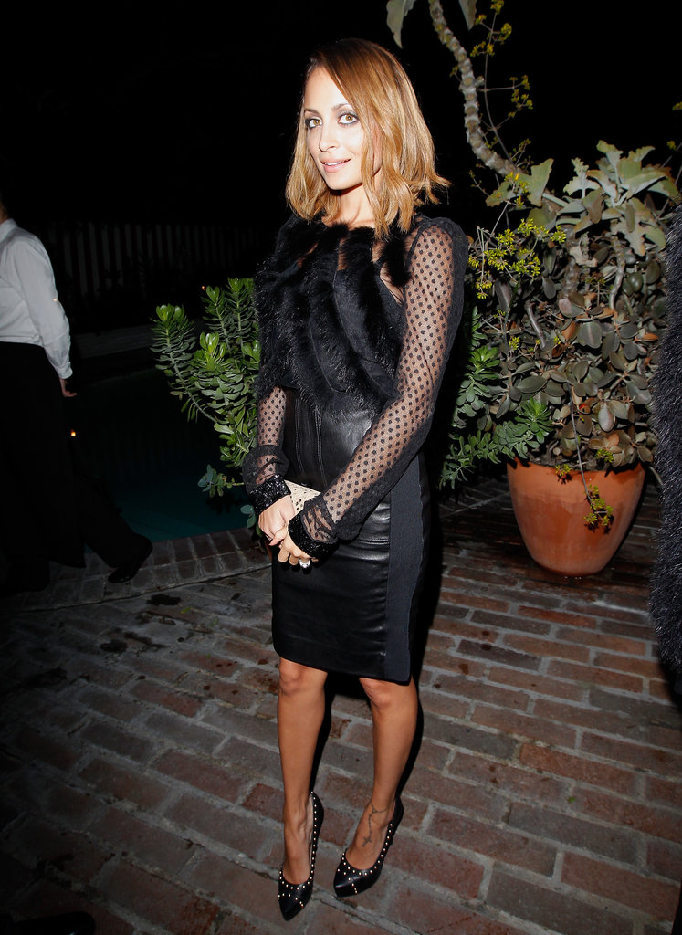 Nicole Richie donned a sexy black ensemble to check out Ferragamo's Spring runway collection in LA.