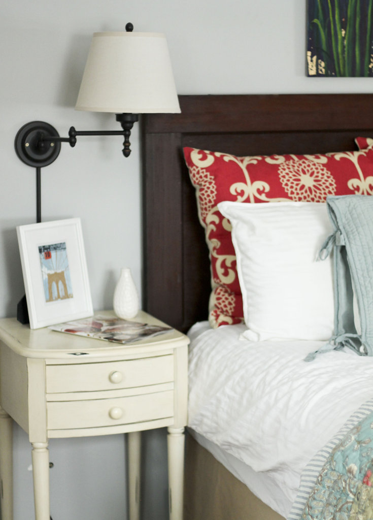 Transform an old door into a handsome wooden headboard.  Source: Pottery Barn Inside & Out