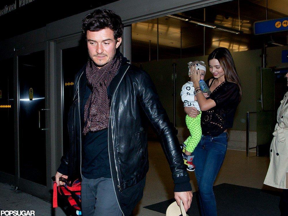 Miranda Kerr arrived at LAX with son Flynn Bloom and husband Orlando Bloom.