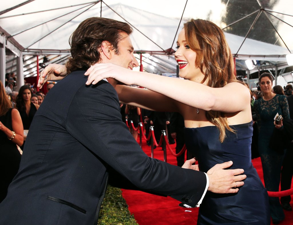 Jennifer Lawrence got a big hug from Bradley Cooper on the SAG Awards red carpet.