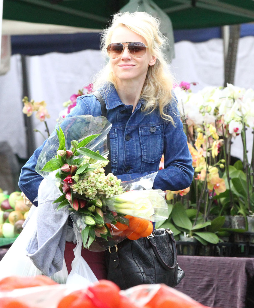 Naomi Watts smiled Sunday in Brentwood.