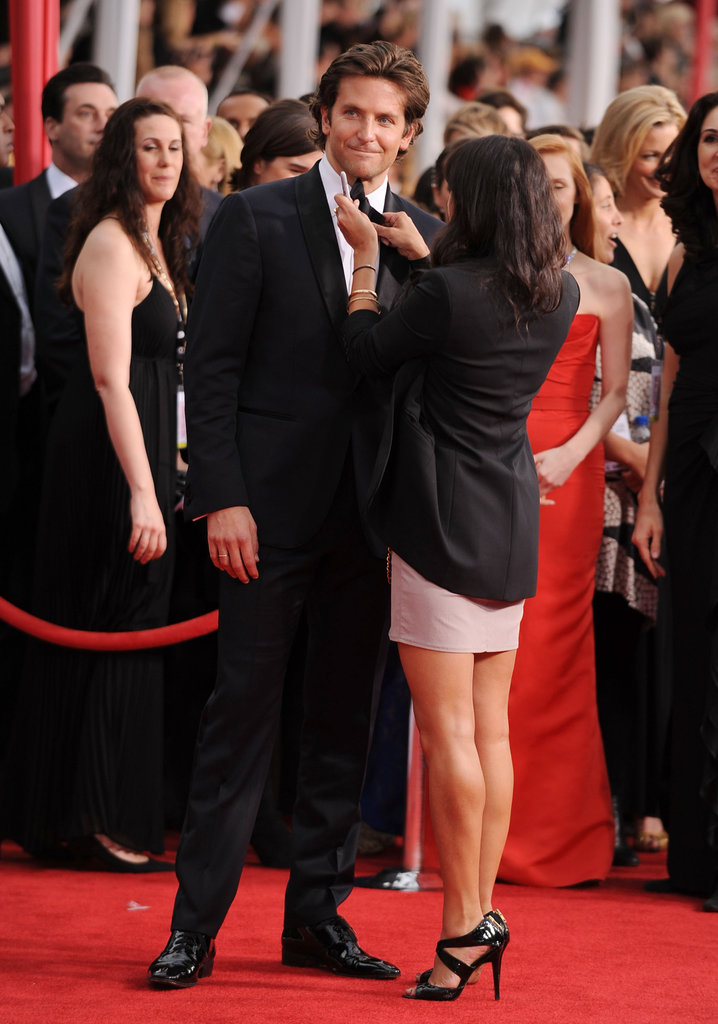 A lucky lady helped keep Bradley Cooper looking good at January's SAG Awards.