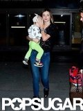 Miranda Kerr carried Flynn Bloom through LAX.